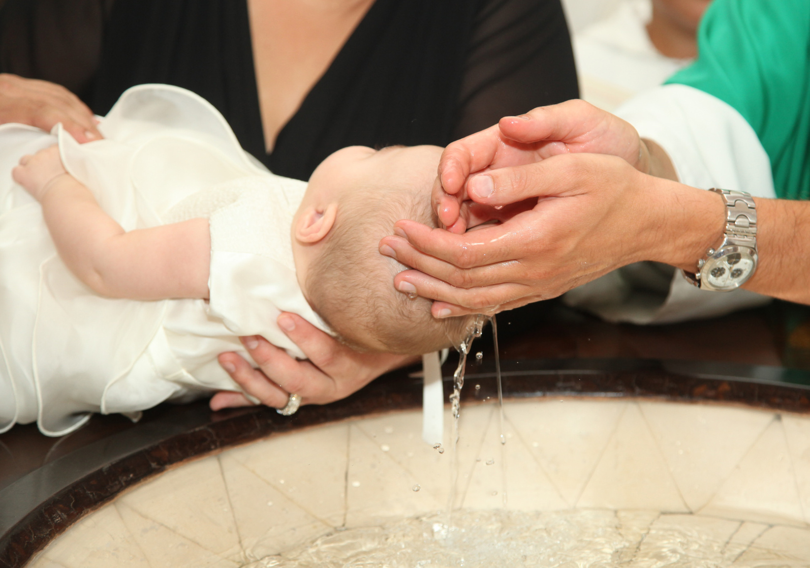 Baptism: meaning, symbols and how to organise one